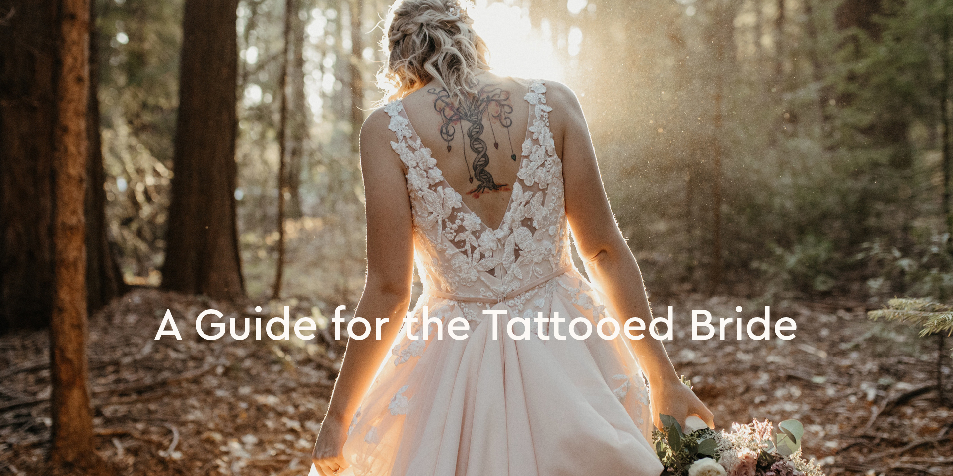 Anomalie bride wearing a laced, low-back dress that flaunts her back tattoo.